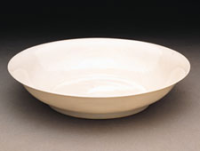Jiangxi Province; Ming period (1368–1644)  early 15th century (probably Yongle era  1403–1424) Porcelain with incised design under glaze (Jingdezhen ware).